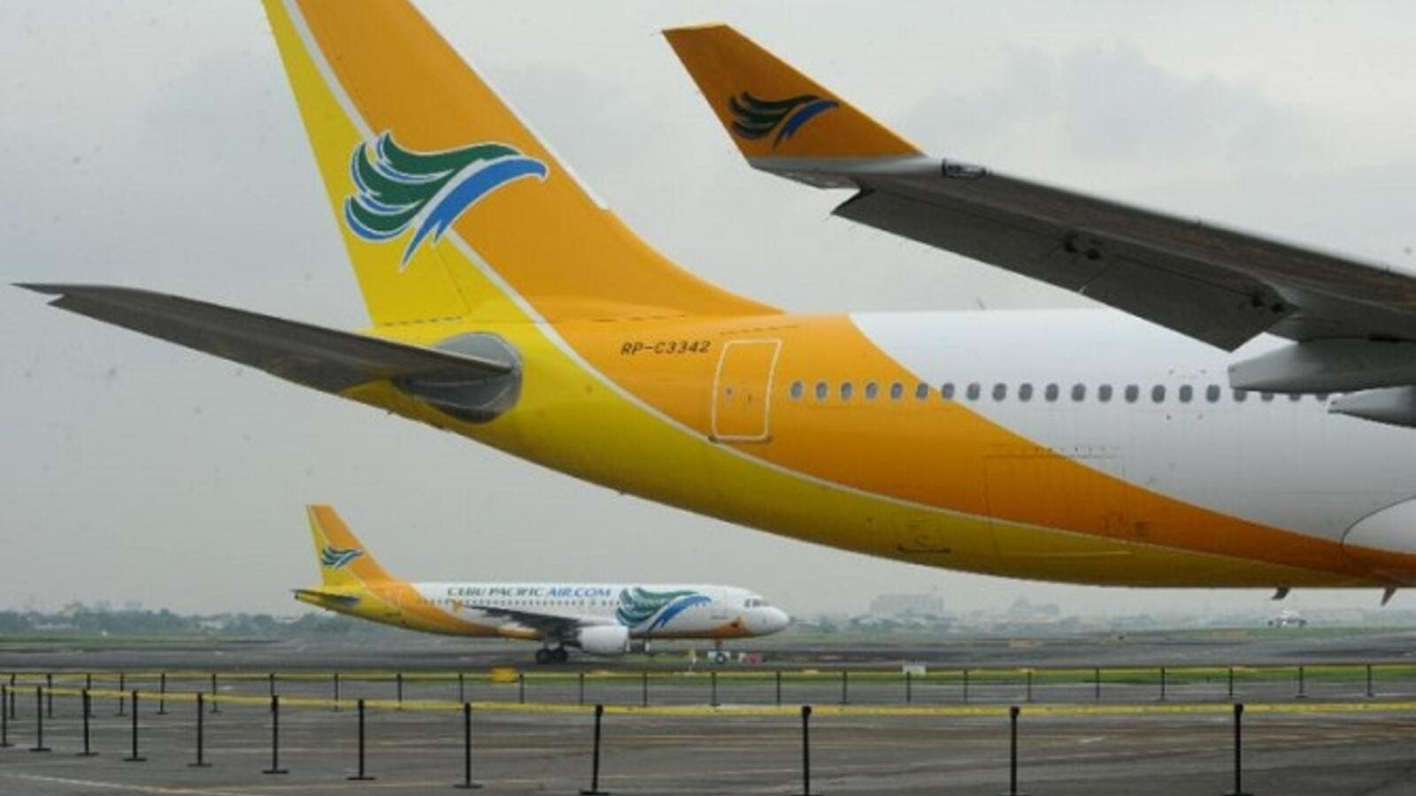 Filipino low-cost airline Cebu Pacific is suspending operations to and from Kuwait, Riyadh and Doha, claiming that these routes are no longer viable. (AFP/ Jay Directo)