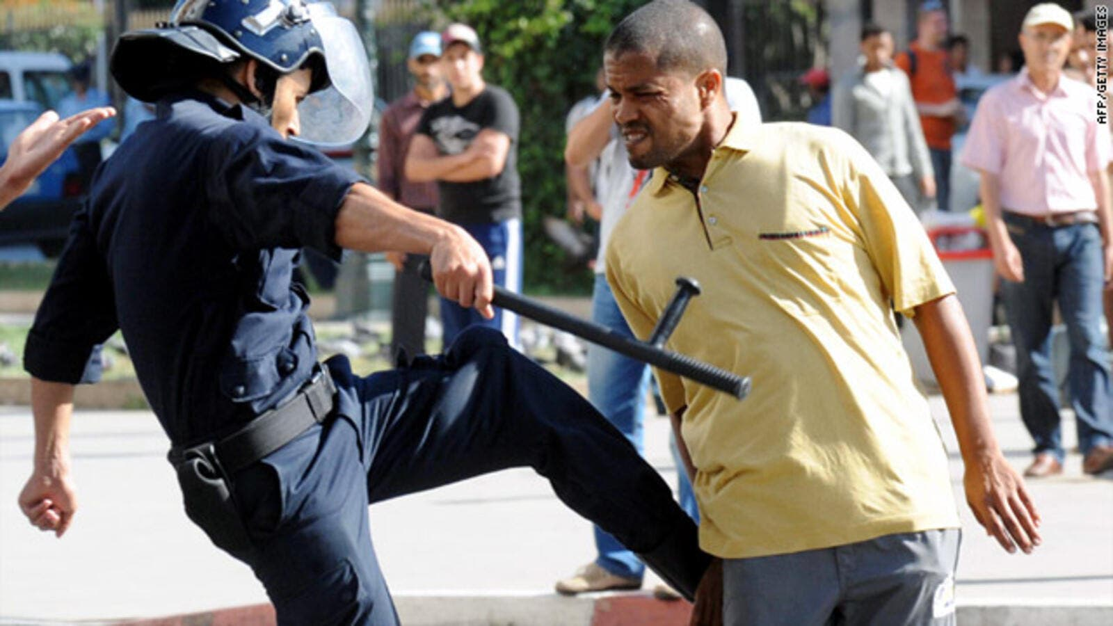 A police officer kicks a demonstrator during a protest in Rabat, Morocco. (AFP/File)