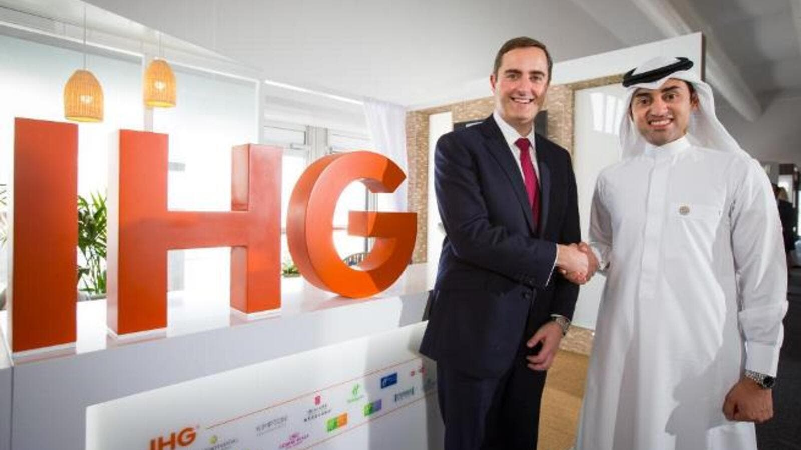 Pascal Gauvin and Sami Alhokair shake hands after signing the agreement. (Courtesy of IHG)