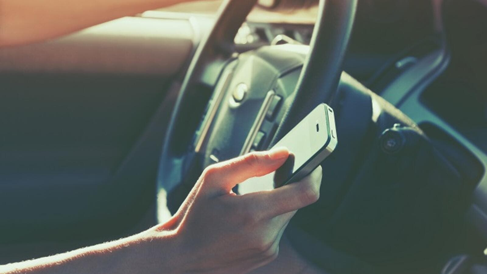 Use of Mobile Phone While Driving a 'Traffic Violation
