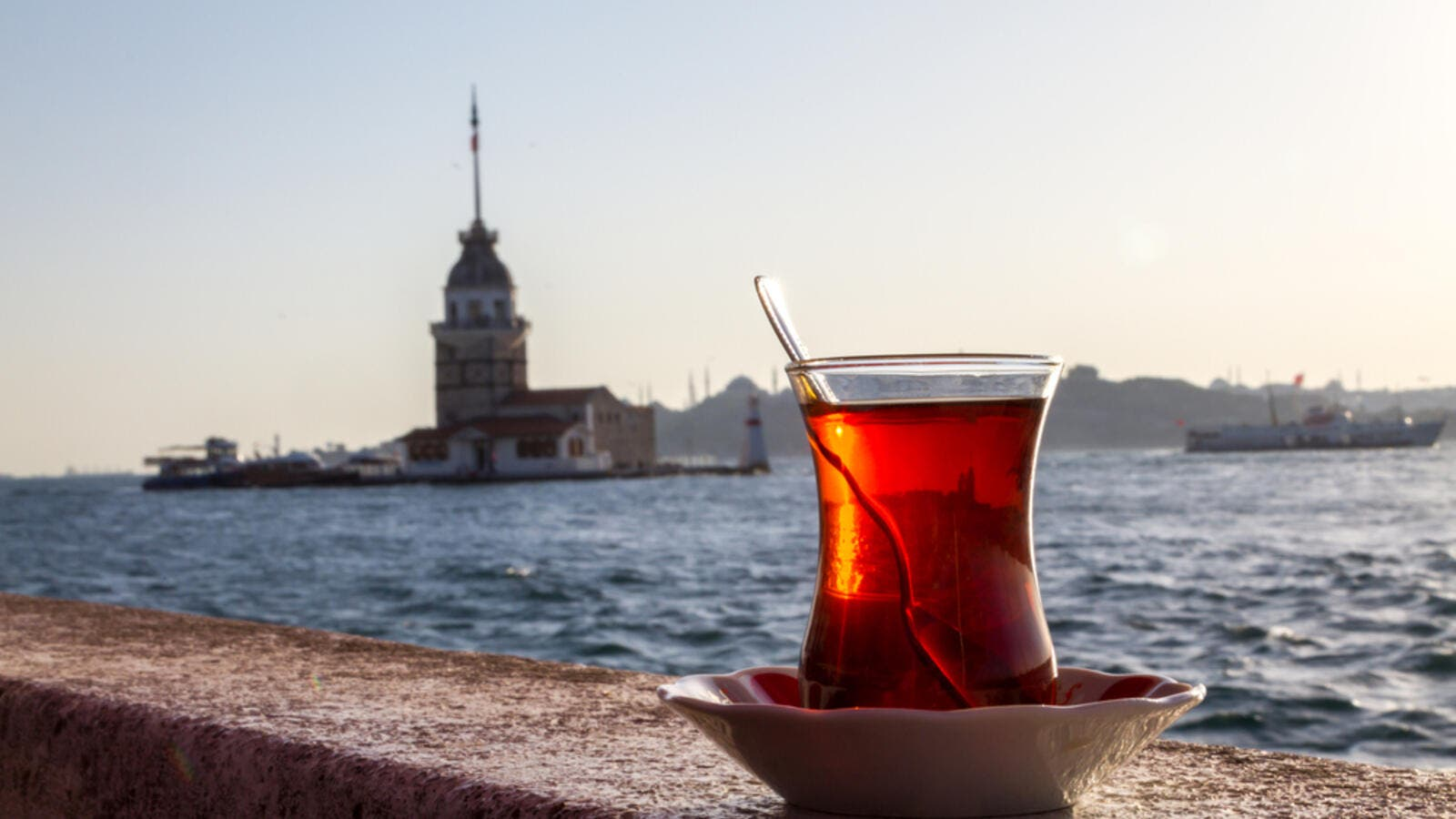 A cup of Turkish tea on the background of the Maiden Tower. (Shutterstock)