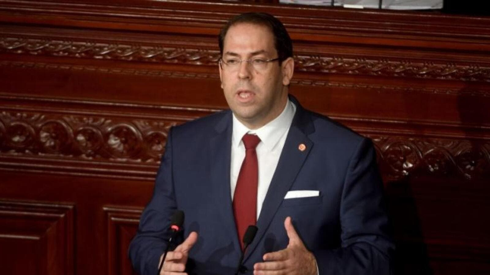 Tunisian Prime Minister Youssef Chahed speaks to the parliament in Tunis. (AFP/File Photo)