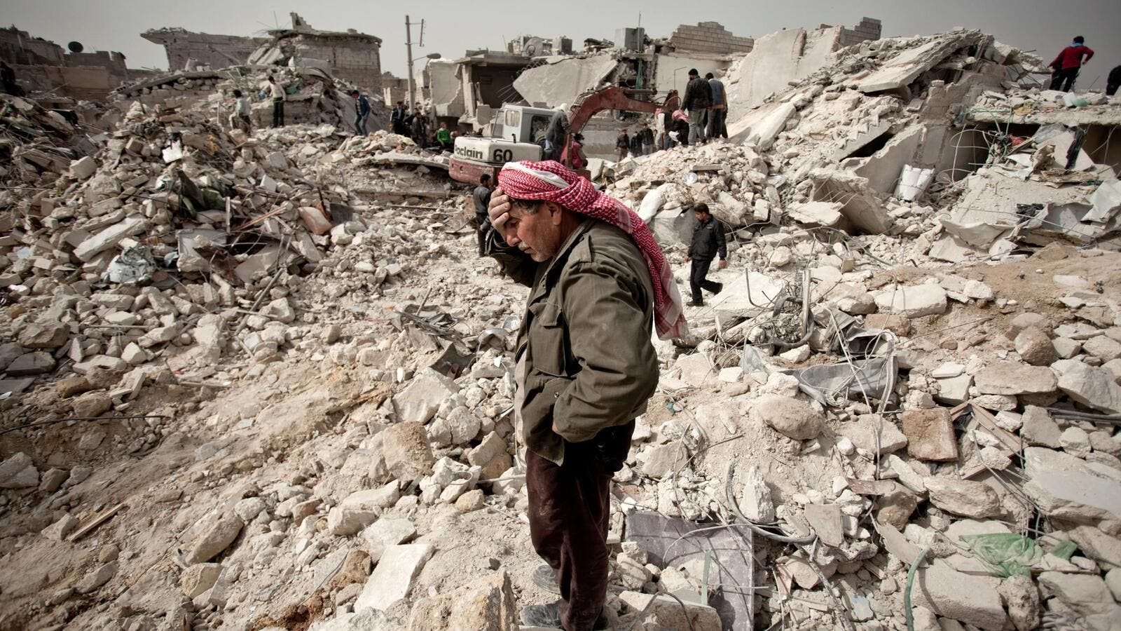 A Syrian man stands over the rubble of his house in Aleppo on February 23, 2013.  (AFP/Pablo Tosco)