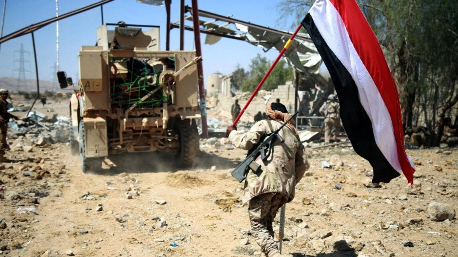 Loyalist forces carrying a Yemeni flag while on patrol in Marib. (AFP/File)