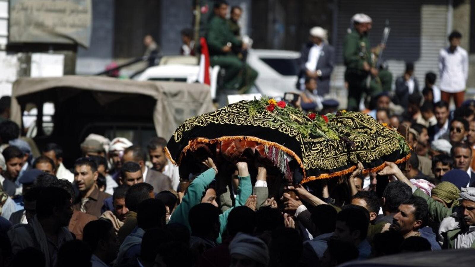 Yemeni mourners carry the coffin of Abdel Qader Hilal, the mayor of the capital Sanaa, on October 10, 2016 after he was killed in an air strike on a funeral in the Yemeni capital three days ago. (AFP/Mohammed Huwais)