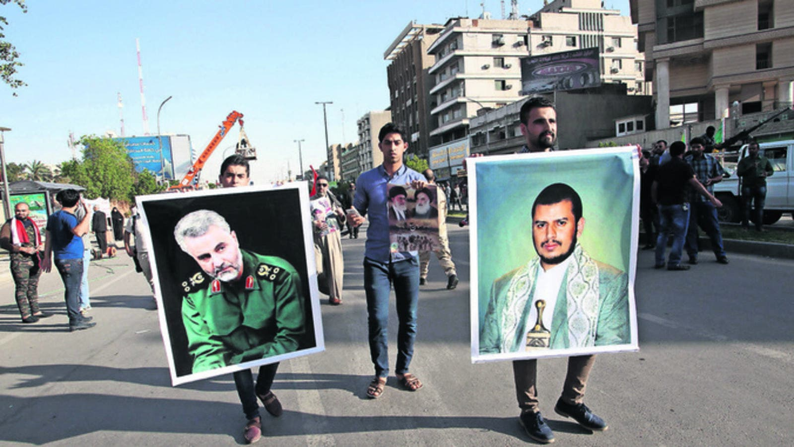 The Saudi-led coalition is battling Shia Houthis, led by Abdul-Malik al-Houthi (right) and is said to be backed by Iranian forces under the command of General Qassem Suleimani (left). (AFP/Ali Al-Saadi)