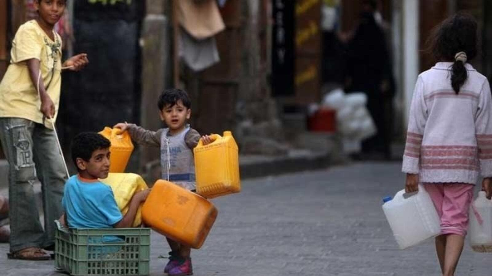 Yemeni children gather fuel, one of the basic needs that's seen a shortage in the country. (AFP/File)