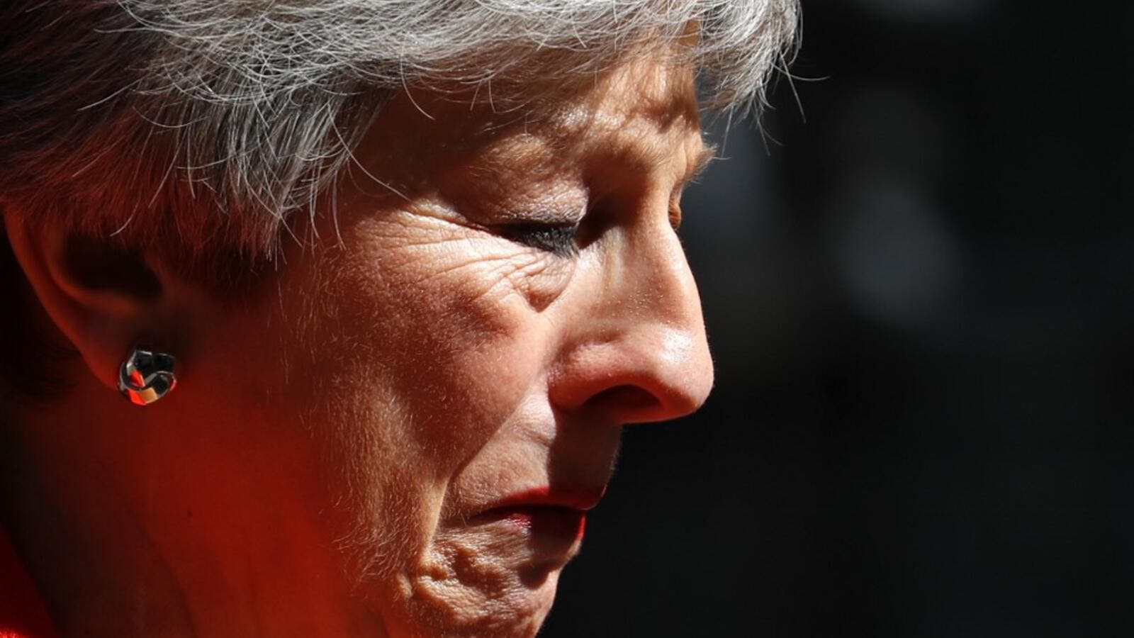 Britain's Prime Minister Theresa May reacts as she announces her resignation outside 10 Downing street in central London on May 24, 2019. Beleaguered British Prime Minister Theresa May announced on Friday that she will resign on June 7, 2019 following a Conservative Party mutiny over her remaining in power. Tolga AKMEN / AFP