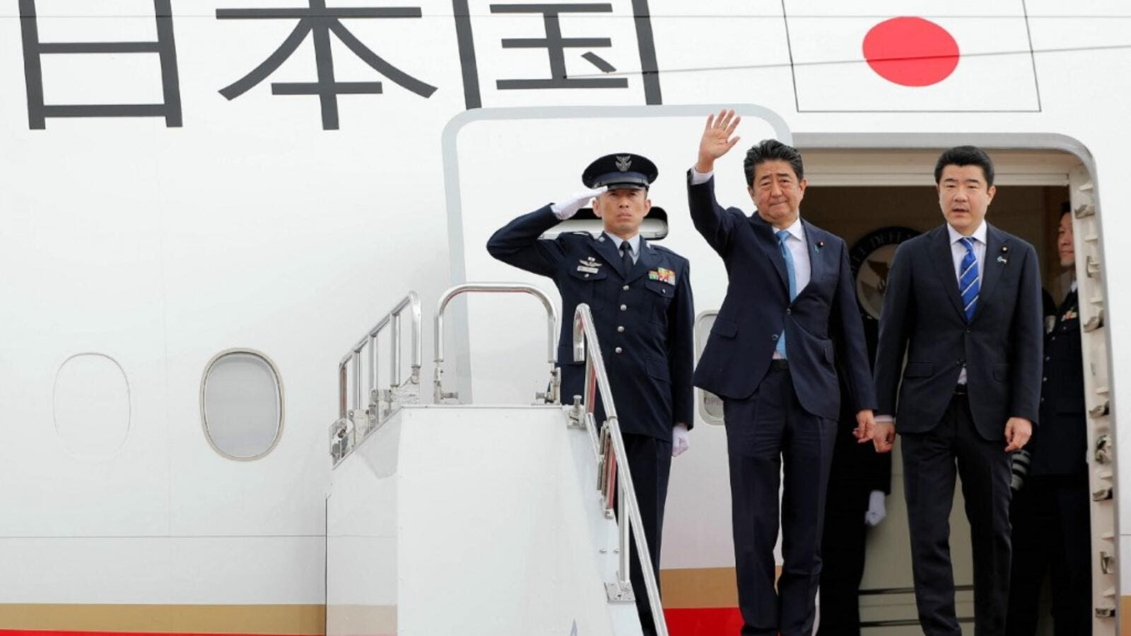 Japan's Prime Minister Shinzo Abe (C) waves to well-wishers upon his departure at Tokyo's Haneda Airport on June 12, 2019. Abe left for a two-day visit to Iran.  JIJI PRESS / AFP