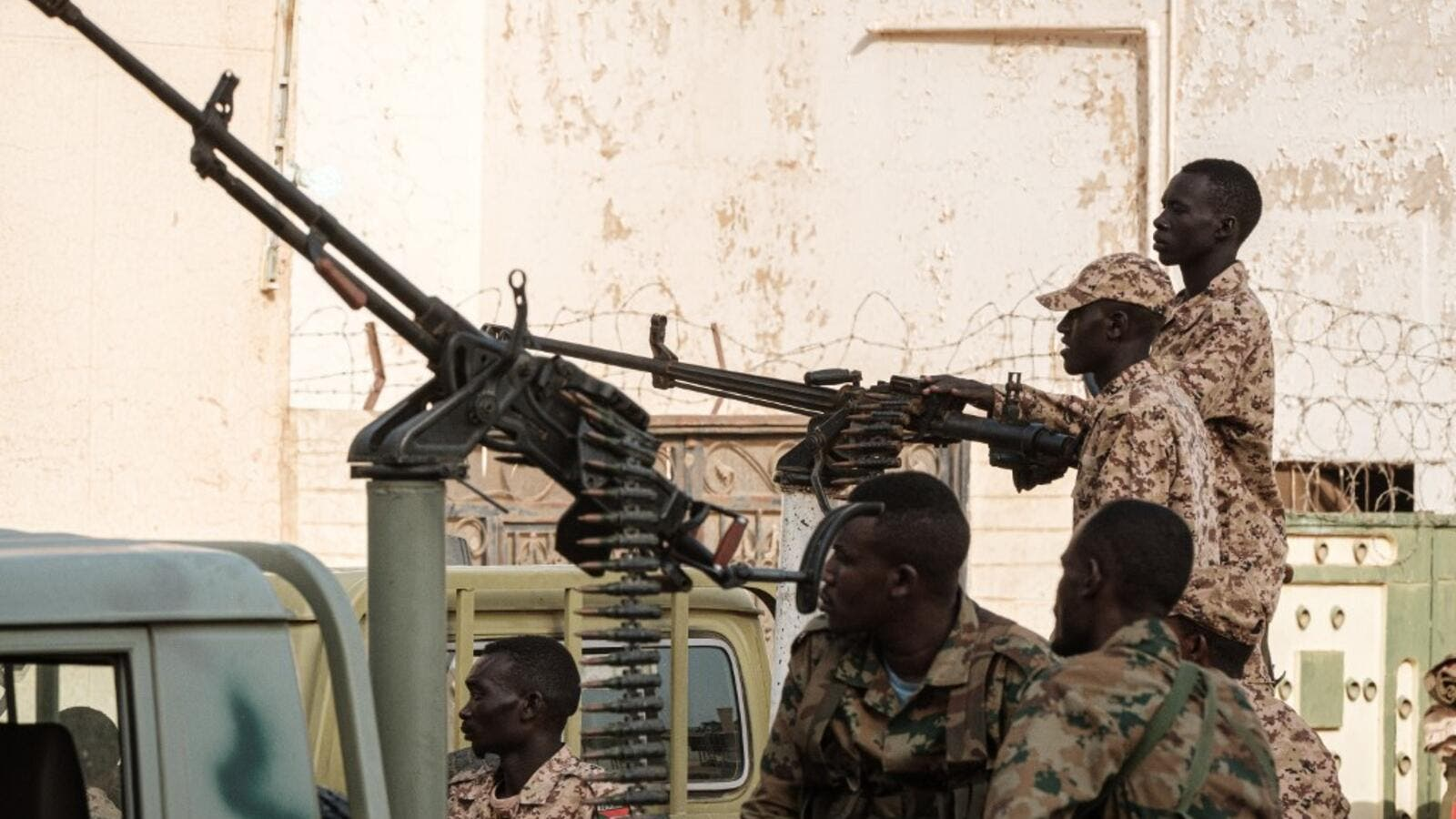 A member of Sudan's Rapid Support Forces (RSF) paramilitaries mans a machine gun turret while on guard outside the offices of the anti-corruption prosecution in the capital Khartoum (AFP)