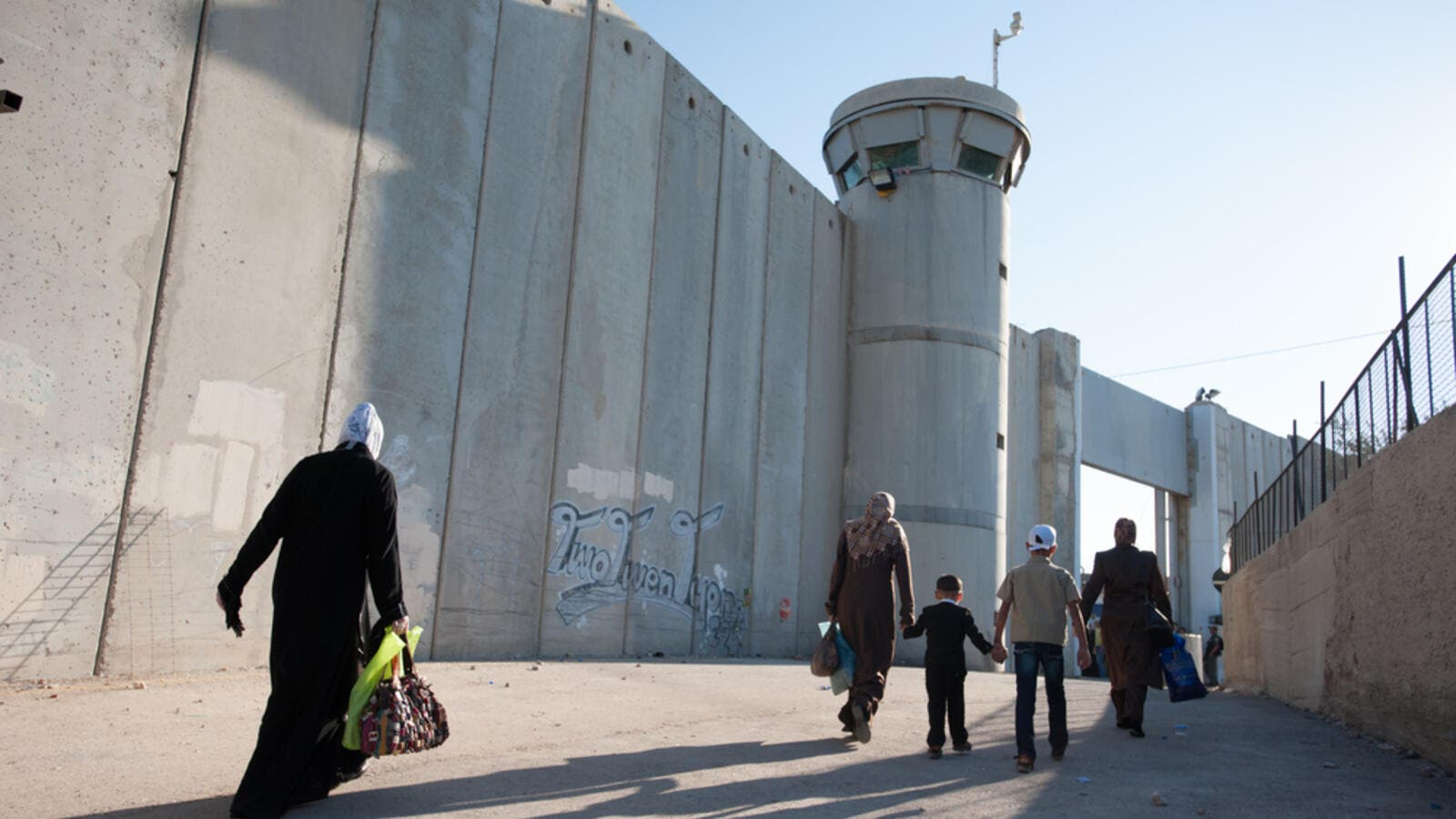 Palestinian women pass through the Bethlehem checkpoint (Shutterstock)