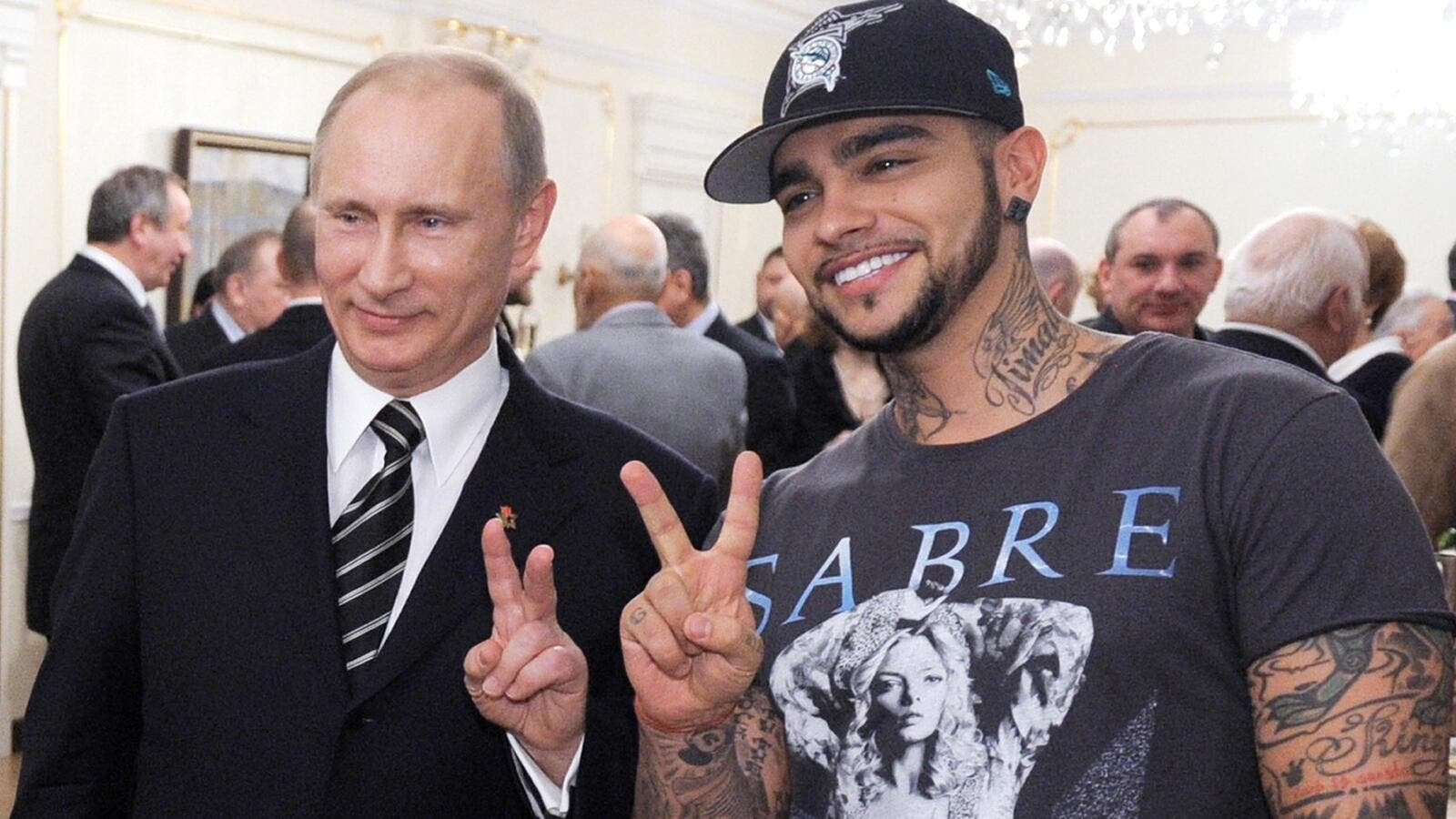 Vladimir Putin posing for a photo with Timati in 2012. Photograph: Alexey Druzhinin/AFP