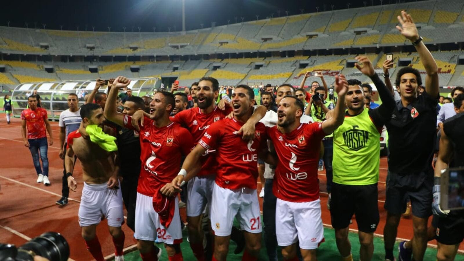 Ahly players celebrate winning title (Photo: Ahram)