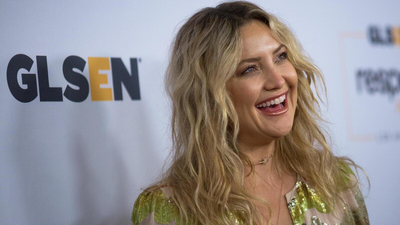 Kate Hudson looks like a ray of sunshine in her golden jumpsuit. (AFP/ File Photo)