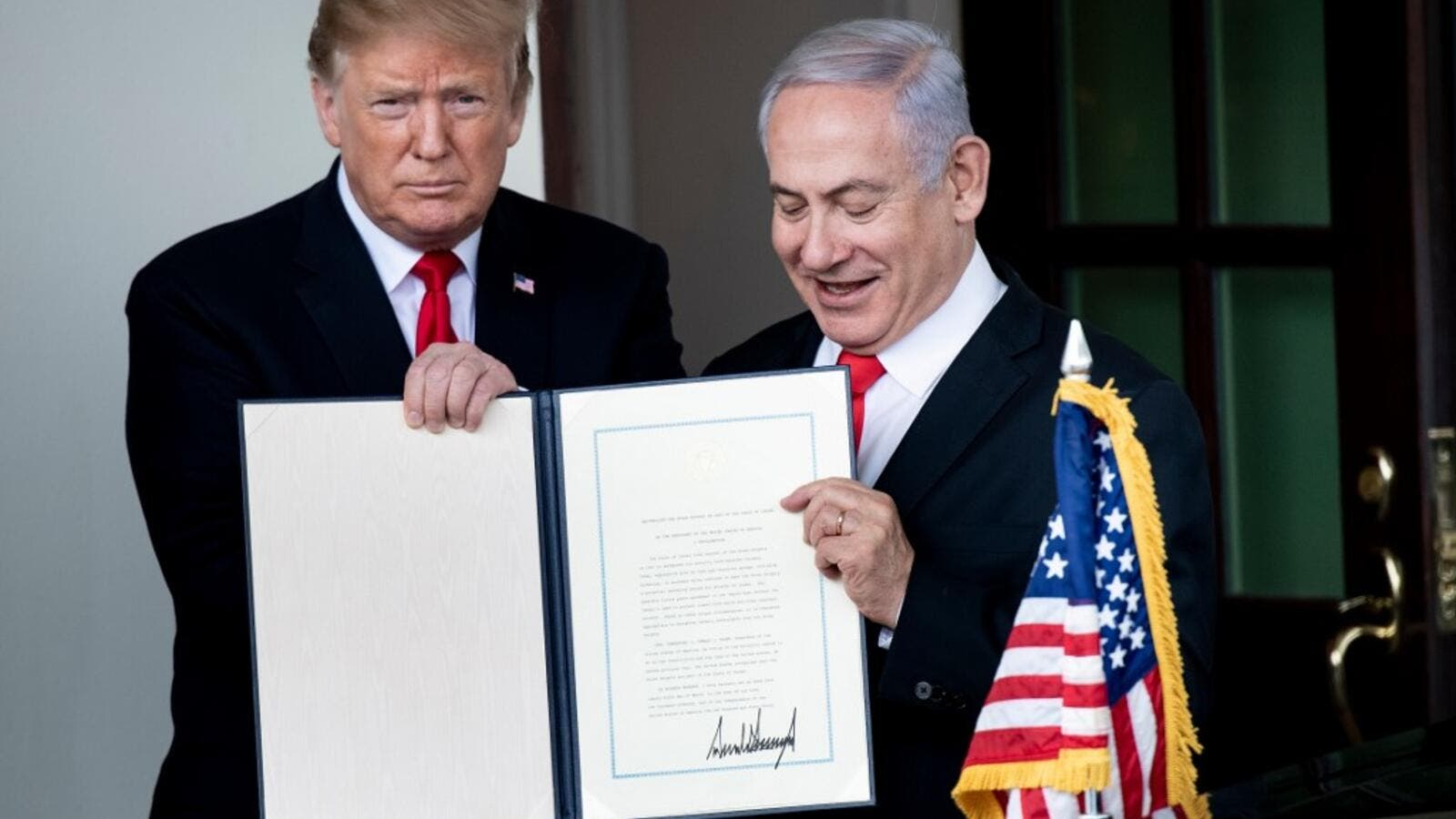 US President Donald Trump (L) and Israel's Prime Minister Benjamin Netanyahu hold up a Golan Heights proclamation. (Brendan Smialowski / AFP)