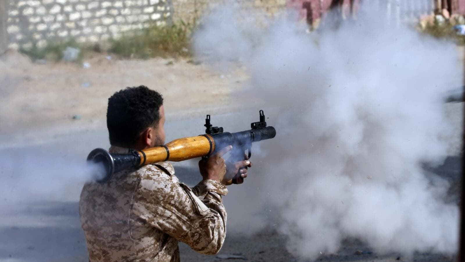 A Libyan fighter loyal to the Government of National Accord (GNA) fires a rocket propelled grenade during clashes with forces loyal to strongman Khalifa Haftar south of the capital Tripoli's suburb of Ain Zara, on April 20, 2019. (AFP)
