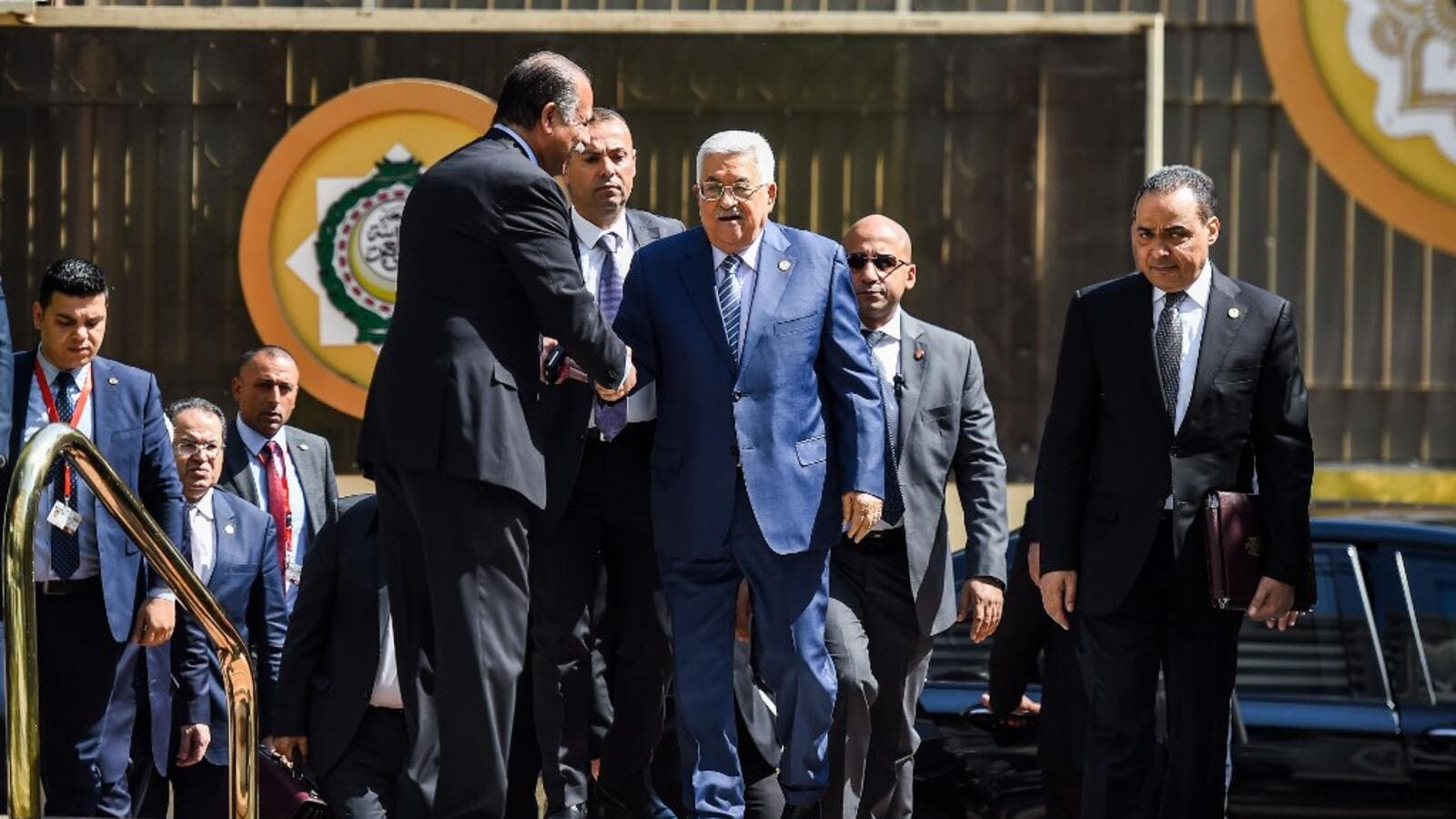 Palestinian president Mahmoud Abbas (C) is greeted upon his arrival at the Arab League headquarters in Cairo, on April 21, 2019. (MOHAMED EL-SHAHED / AFP)