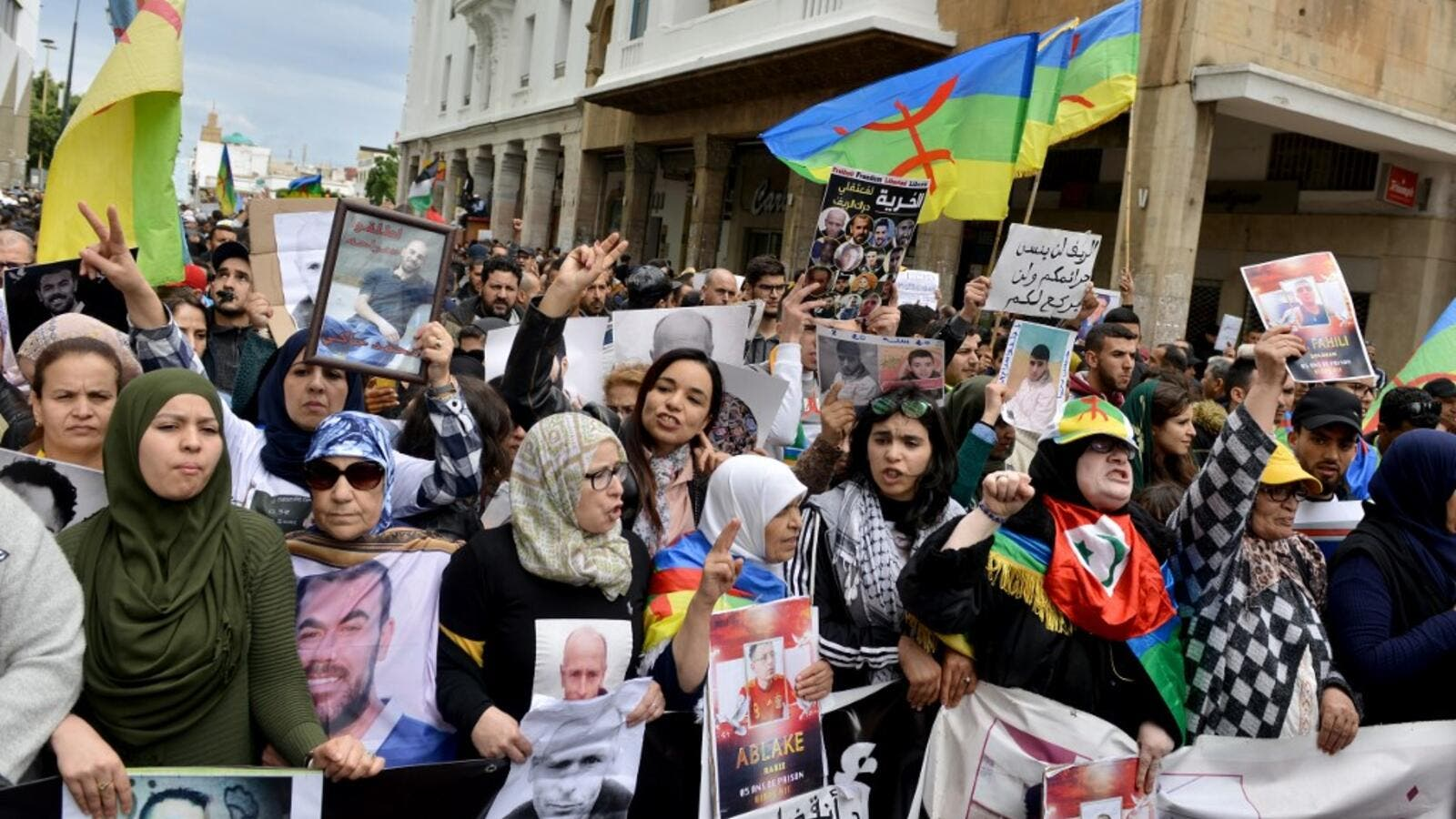 "Moroccans shout slogans while waving the Berber, or Amazigh, flag during a demonstration against the court of appeal rulings on Al-Hirak al-Shaabi or ""Popular Movement"" activists, in the capital Rabat on April 21, 2019. (AFP/ File)"