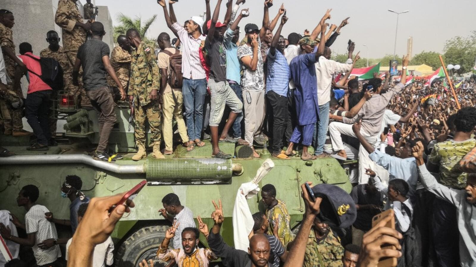 Sudanese anti-regime demonstrators stand on an army armoured military vehicle on April 11, 2019. (AFP/ File Photo)