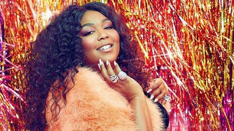 Lizzo Shows Off Curvaceous Figure in Red Thong