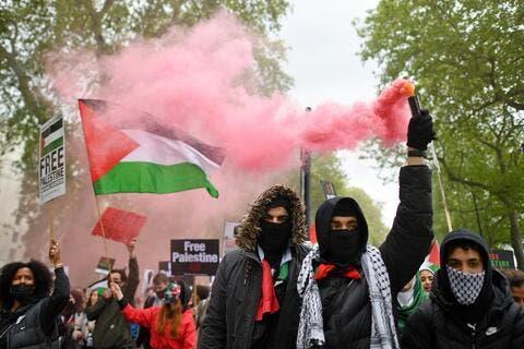 Pro-Palestine Supporters Burn Israeli Flags in London