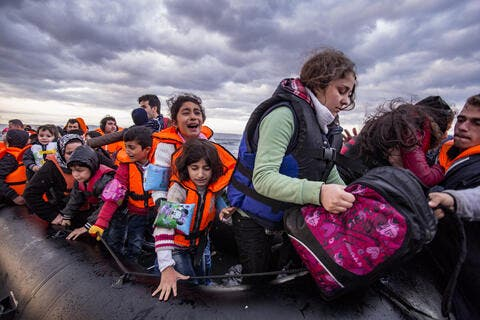 Hundreds of Migrants Flee Libya, Tunisia to Italian Island