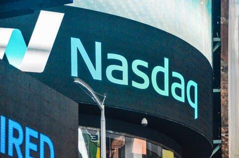 Tesla Lifts Nasdaq to Record-High Close
