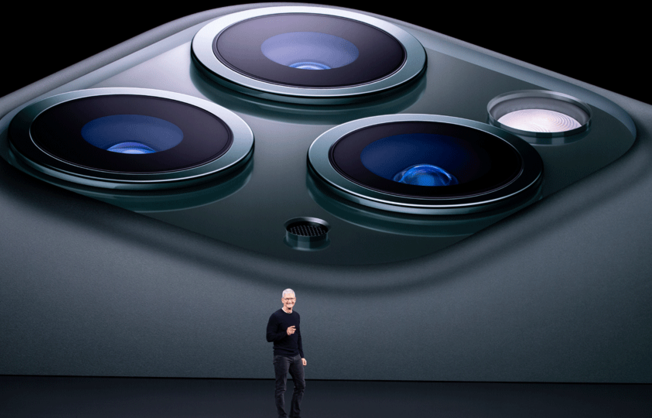 Apple CEO Tim Cook speaks on-stage during a product launch event at Apple's headquarters in Cupertino, California on September 10, 2019. Apple unveiled its iPhone 11 models Tuesday, touting upgraded, ultra-wide cameras as it updated its popular smartphone lineup and cut its entry price to $699.